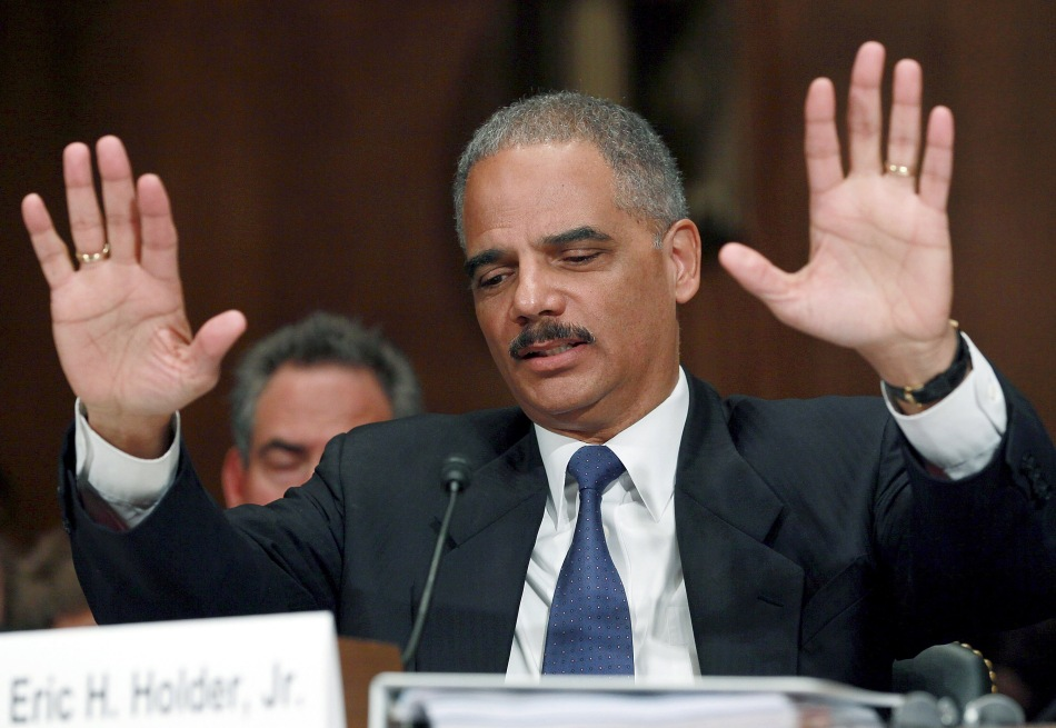 "Holder: Trump ""crossed the line,"" saying Obama didn't call Gold Star families"